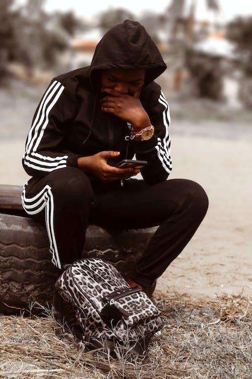 Free stock photo of hoody sweater, mobile phone, wireless communication