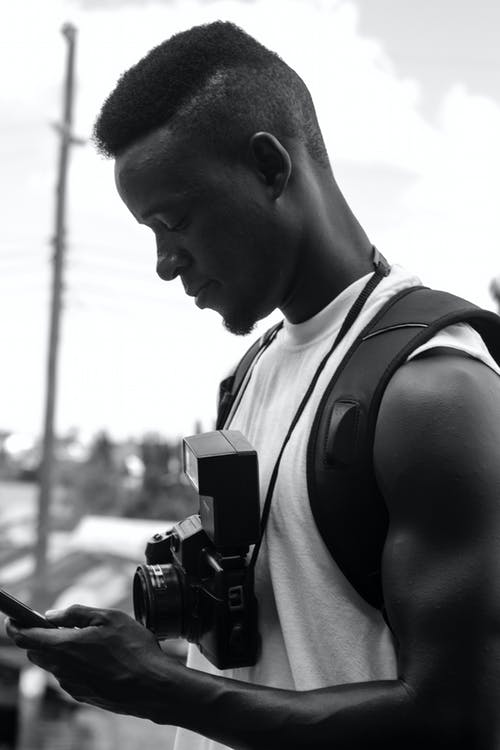 Free stock photo of african man, analog camera, black-and-white