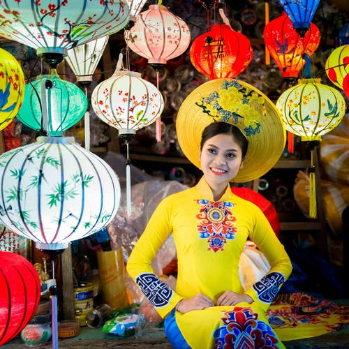 Woman Sitting Near Paper Lanterns