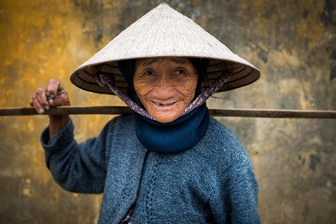 An Elderly Person Wearing Brown Sakkat Hat