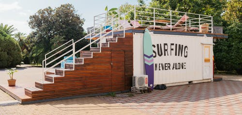 Blue and Purple Surfboard Besides White Ac Condenser