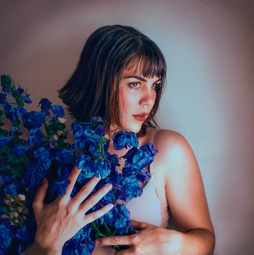 Woman Holding Blue Flower Bouquet