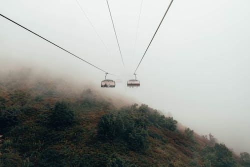 Бесплатное стоковое фото с гора, горнолыжный подъемник, дневной свет, езда