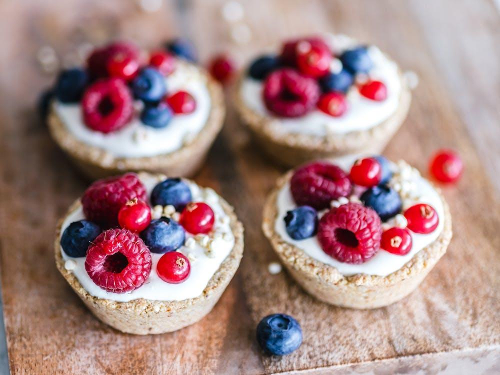 Close-Up Photo Of Raspberries Cupcake