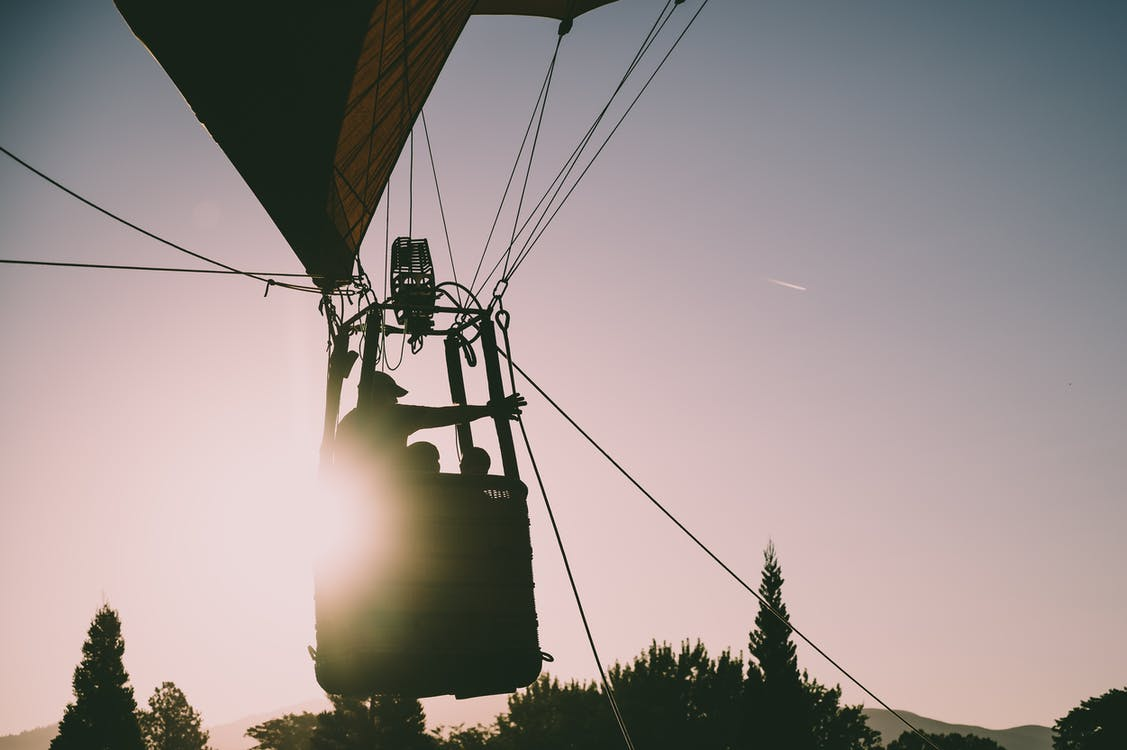 Silhouette of People Riding Hot Air Balloon