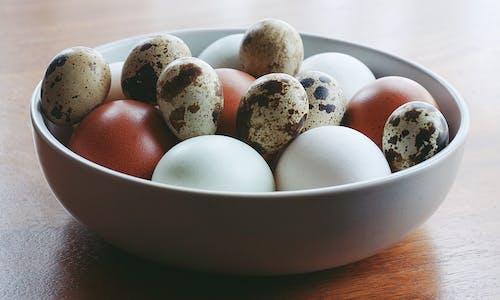 Quail Eggs And White Eggs On A Bowl