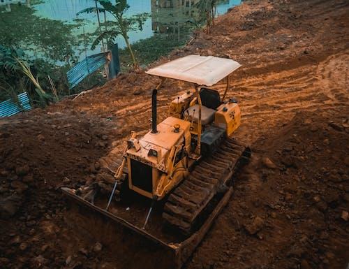 Fotos de stock gratuitas de color naranja, embarrado, mancha, maquinaria de construcción