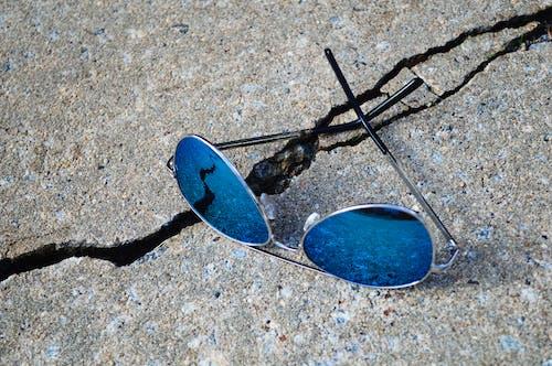 Free stock photo of aviator sunglasses, blue, concrete