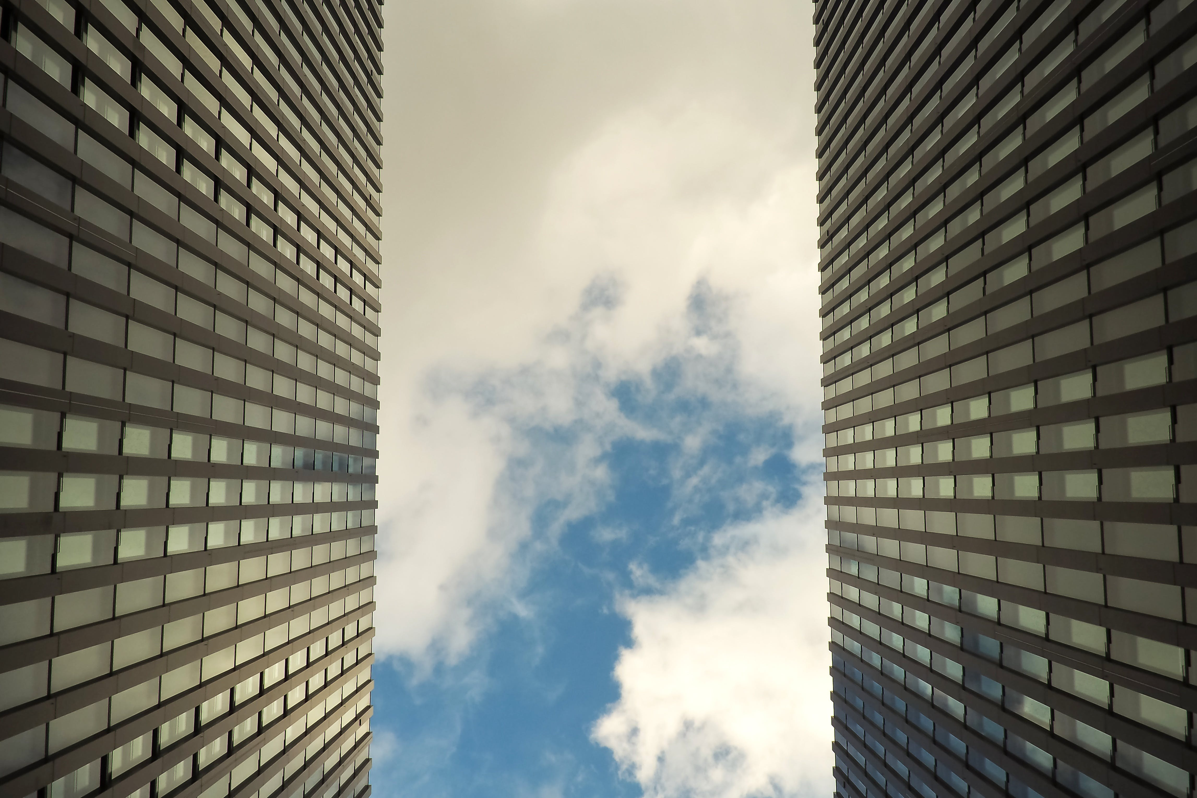 Worm's-eye View Photography of Building Under Cloudy Sky