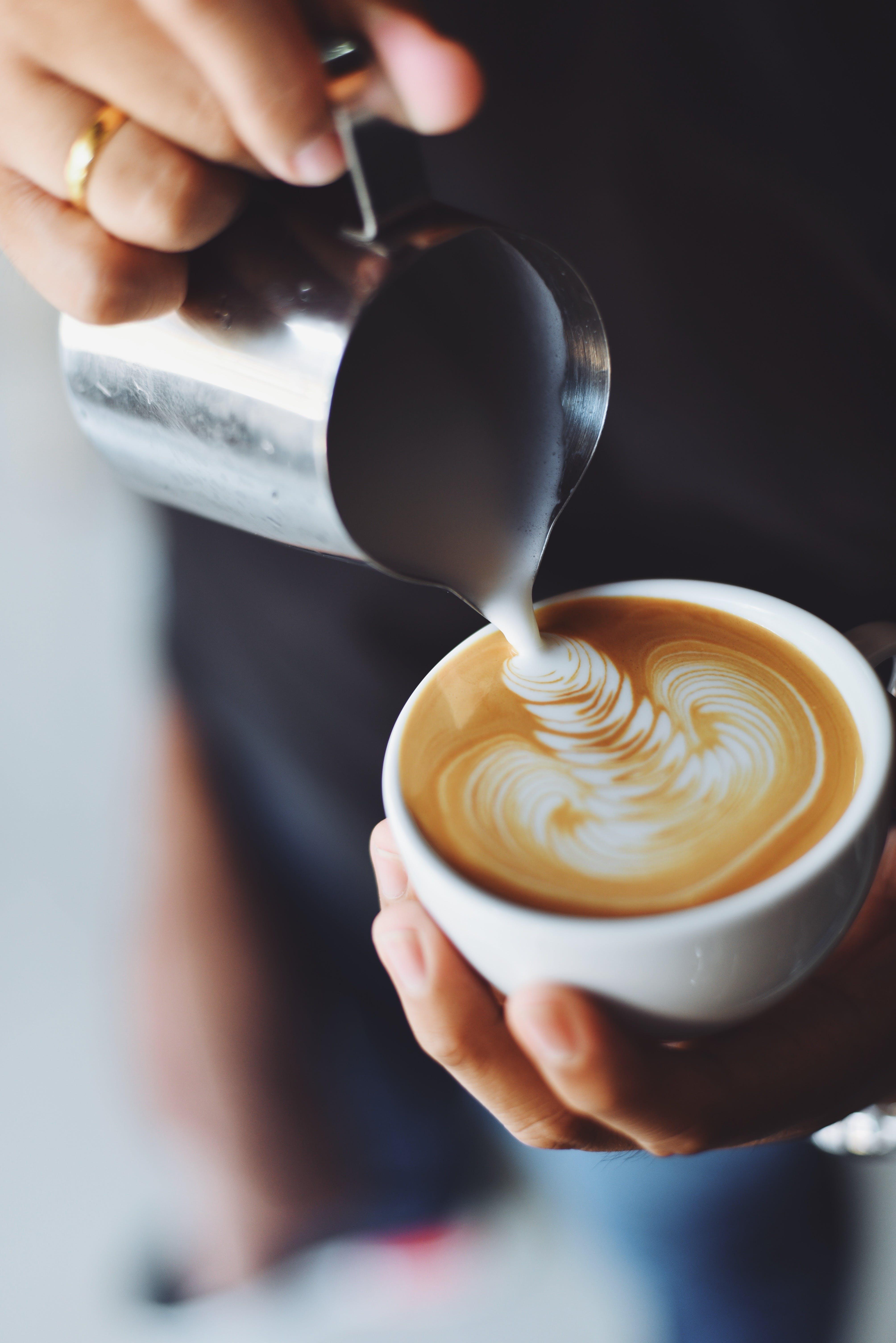 Person Making Espresso