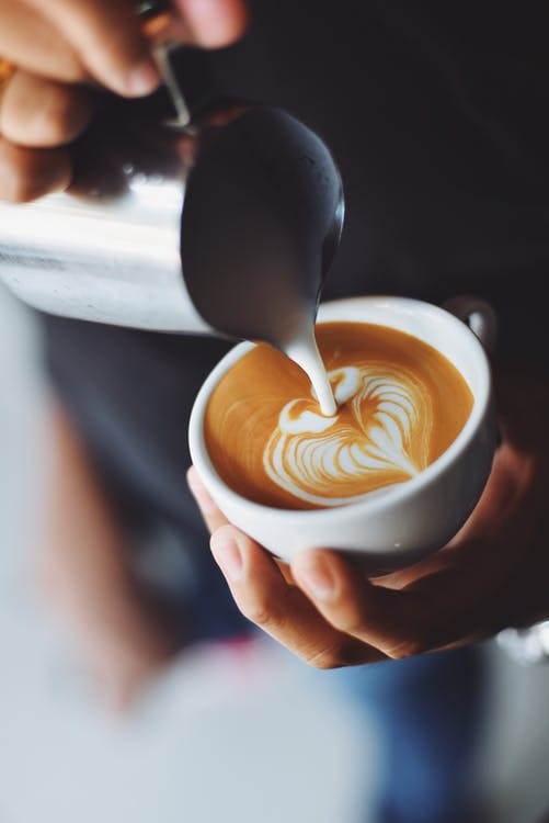 Woman Pouring Cappuccino