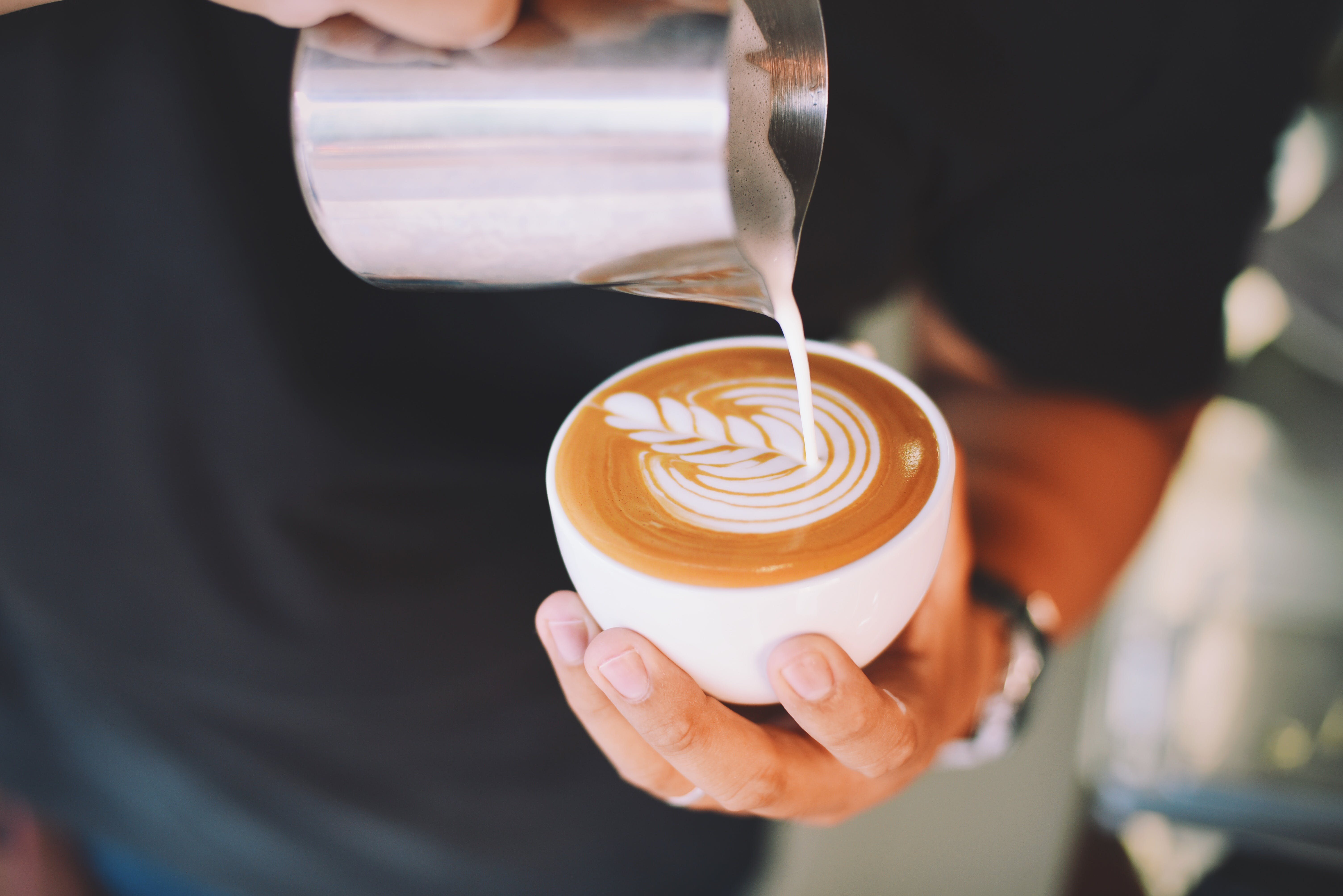 Close-up of Hand Holding Cappuccino