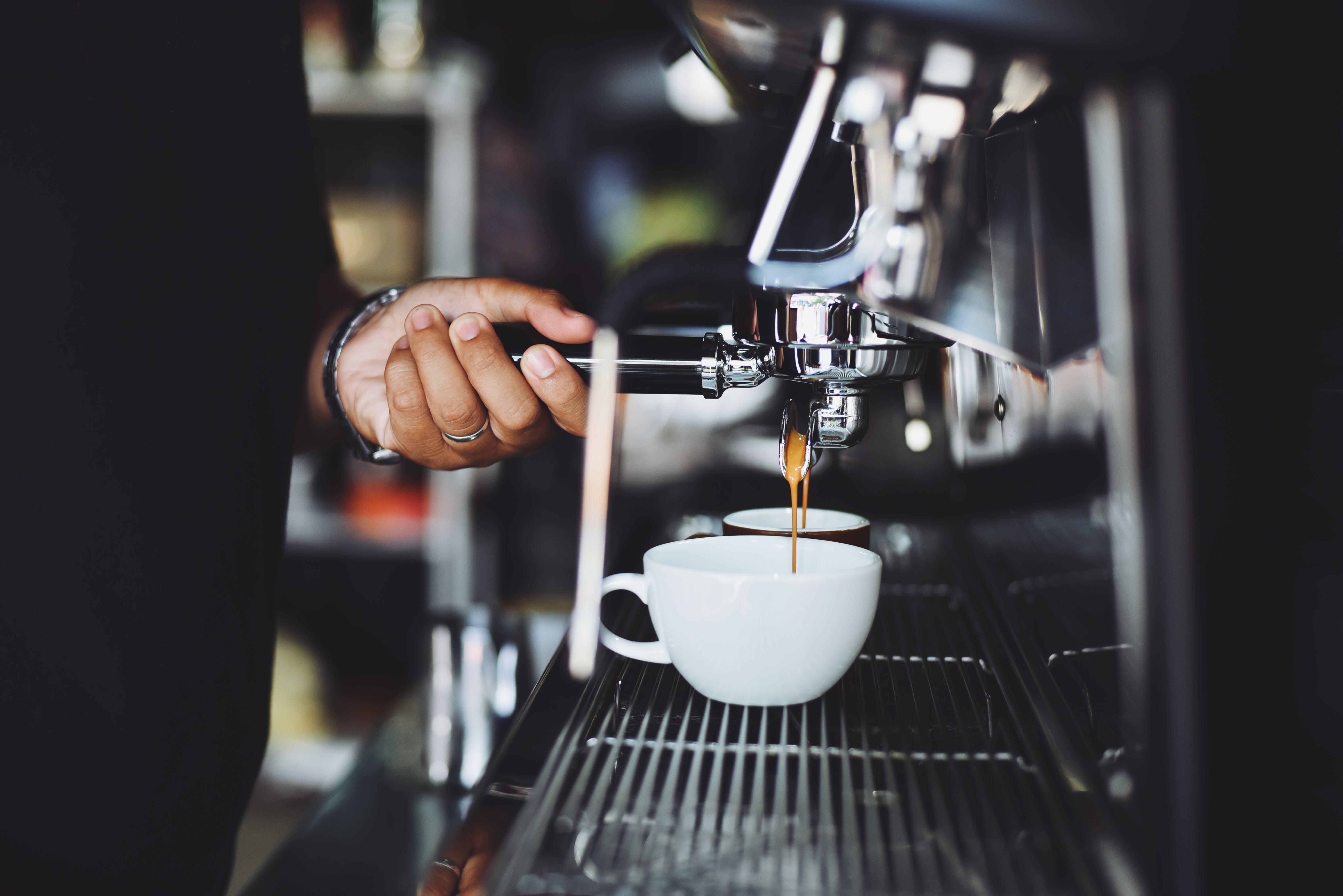 Close-up of Hand Holding Coffee Machine