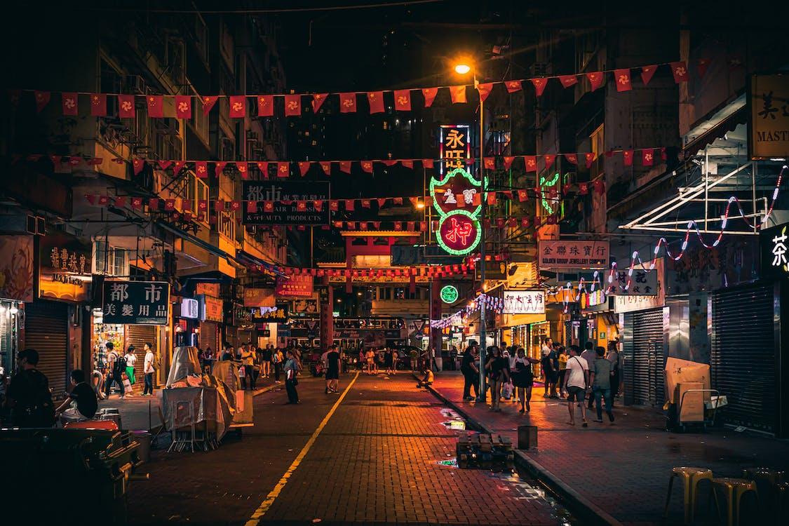 Photo of People Walking on Street During Night