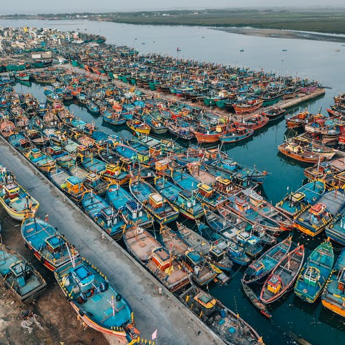 Photo of Fishing Boats Docked on Port