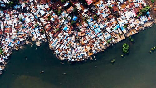 Aerial View Of  Roofs Of  Houses Along The River