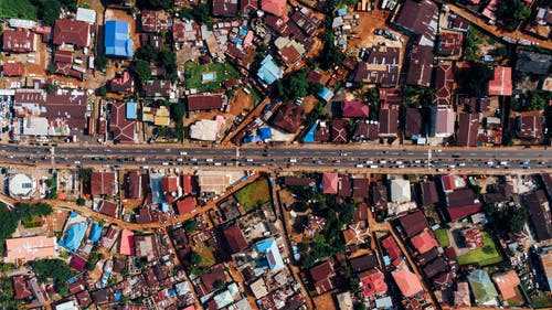 Aerial Photography of Road Between Houses