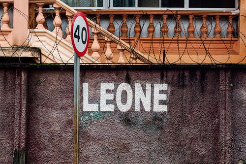Gray 40 Road Sign Beside Wall With Leone Paint