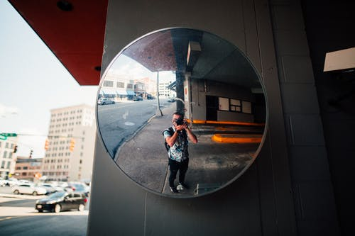 Man Standing in Front of the Mirror