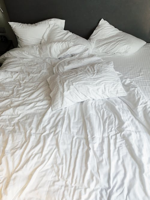 White Pillows And Bed Linen