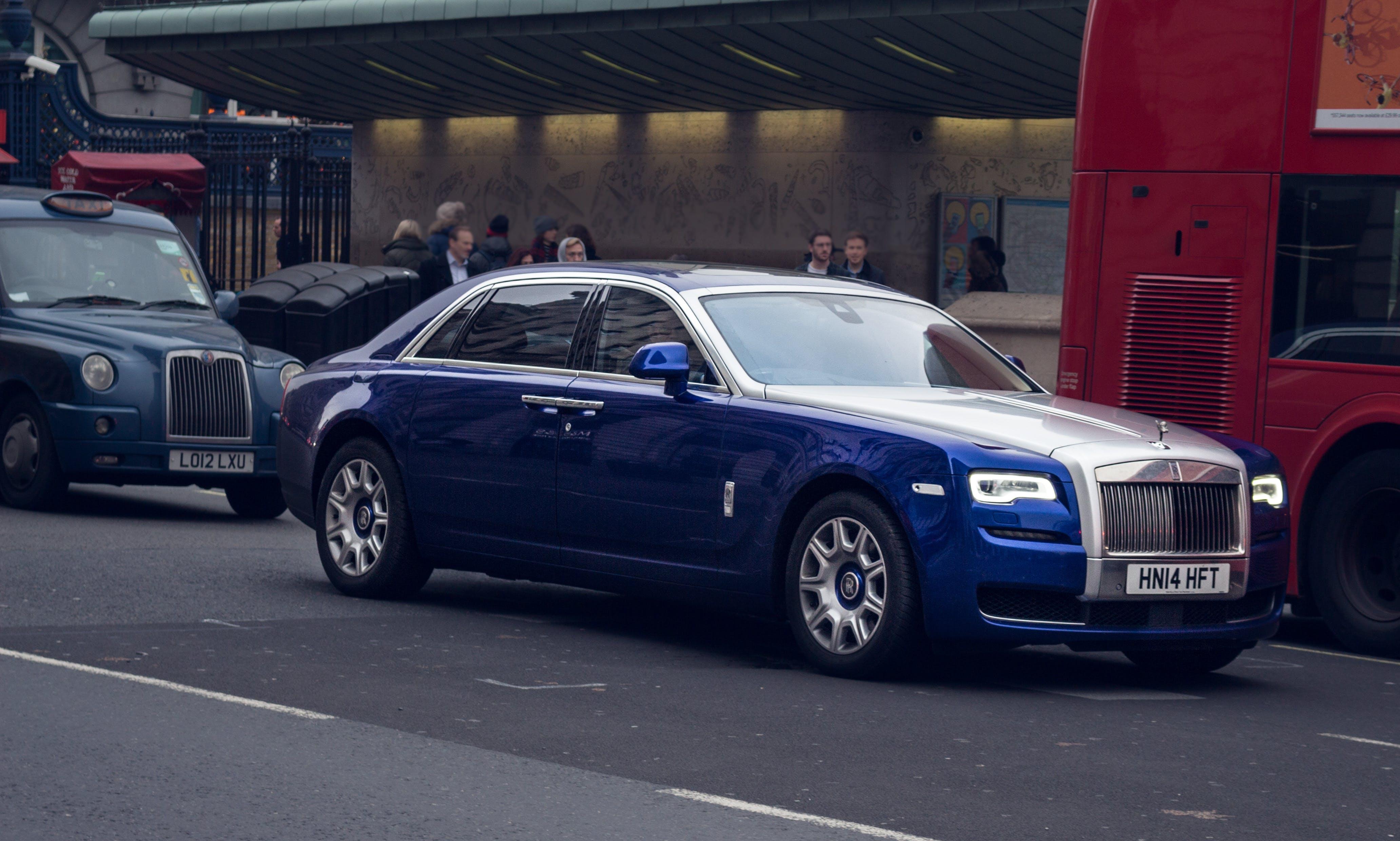 Blue and Silver Rolls Royce Sedan