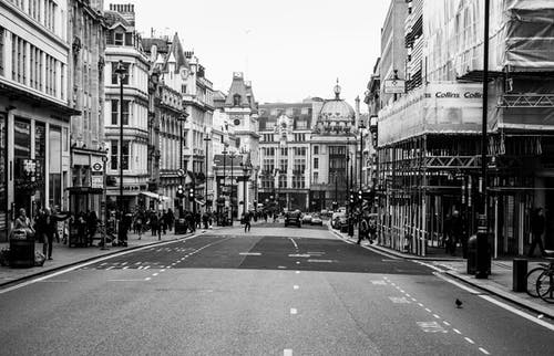 Grayscale Photo of Street and Buildings