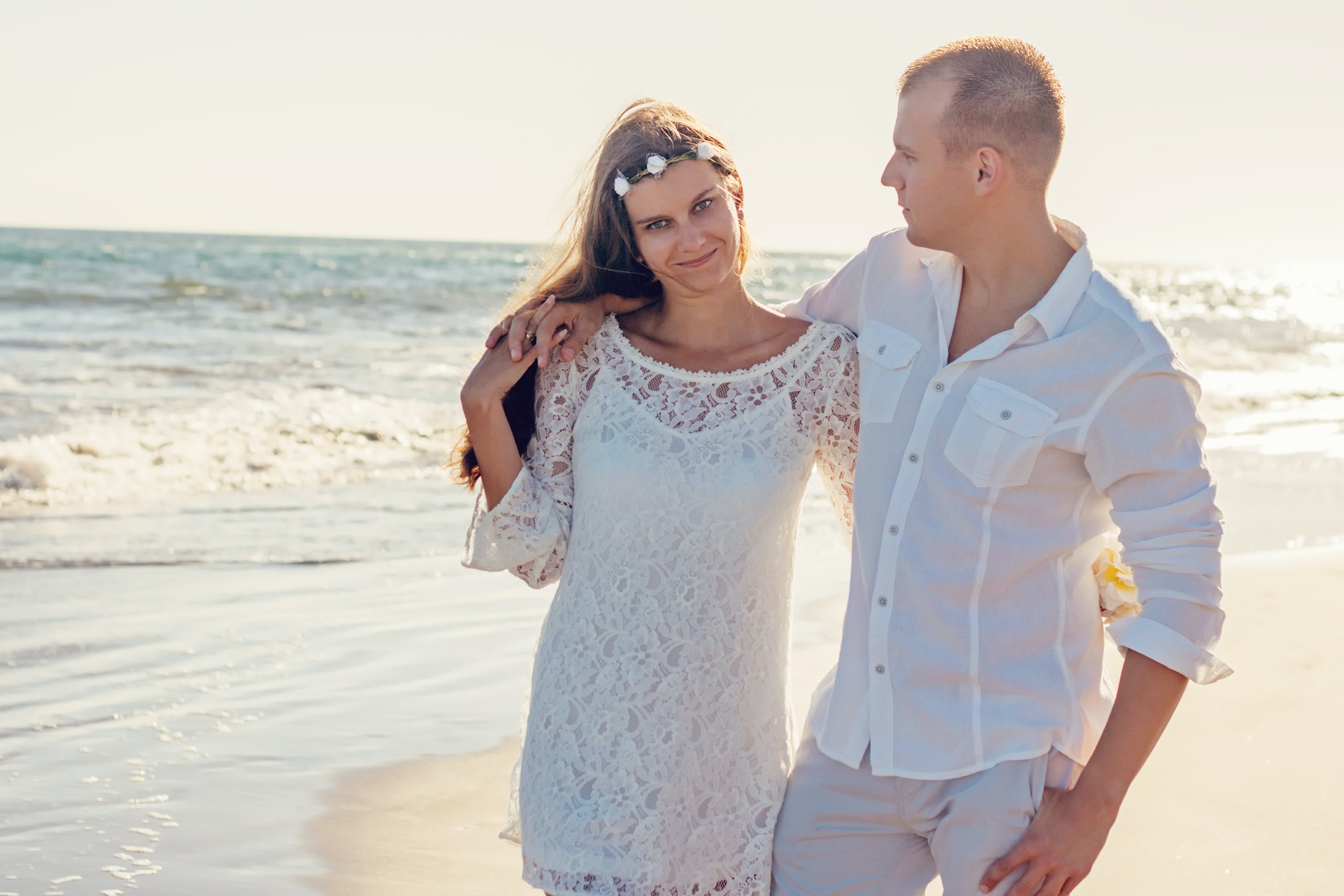 Woman and Man Standing Near on Body of Water