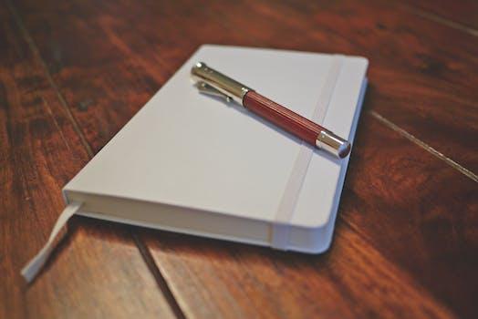 Free stock photo of wood, desk, notebook, pen