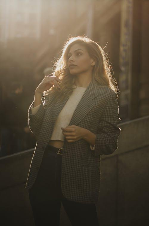 Women In Casual Wear Sporting A Gray Suit Jacket