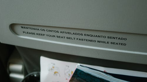 Close-up Of Aviation Policy On The Back Of An Airplane Seat