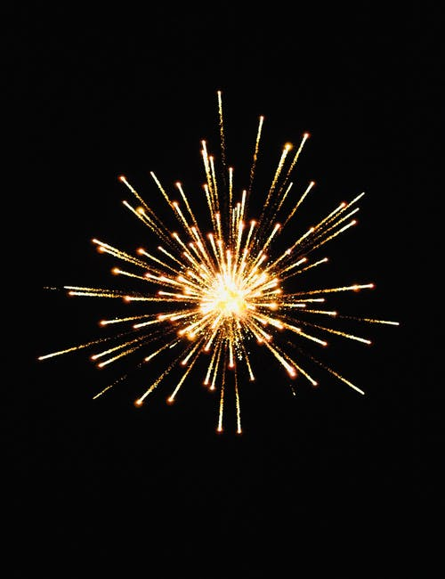 Golden firework in night sky