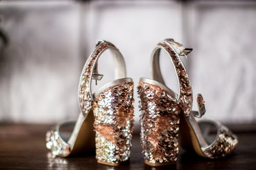 Selective Focus Photography of Silver and Bronze Colored Sequin Open-toe Sandals