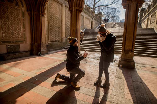 Man on One Knee Proposing to a Woman