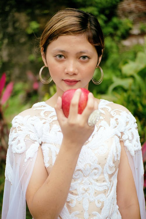 Photo Of Woman Holding Apple