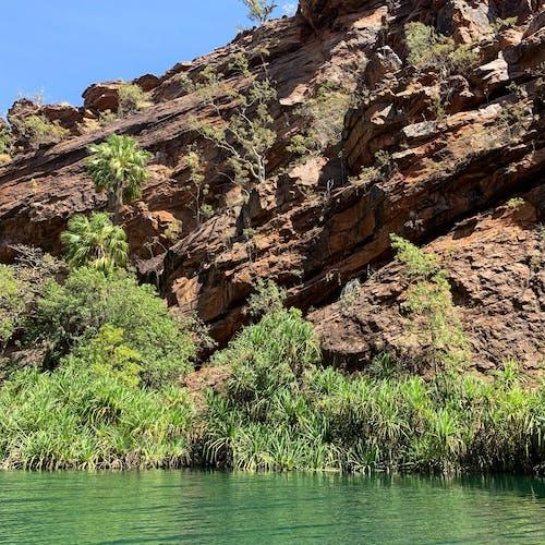 Free stock photo of calm water, earth, rocks