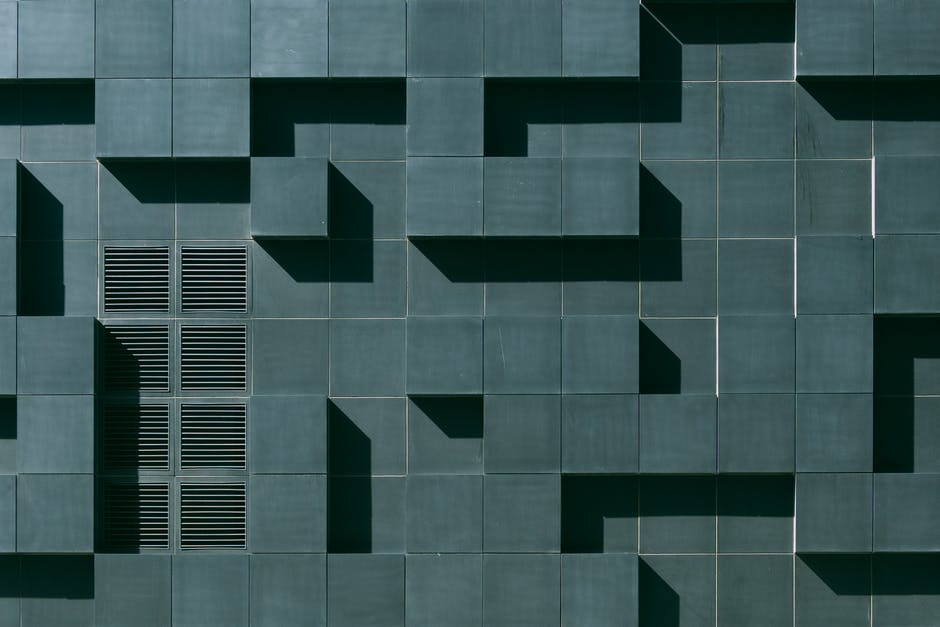 Gray concrete building exterior with geometric design