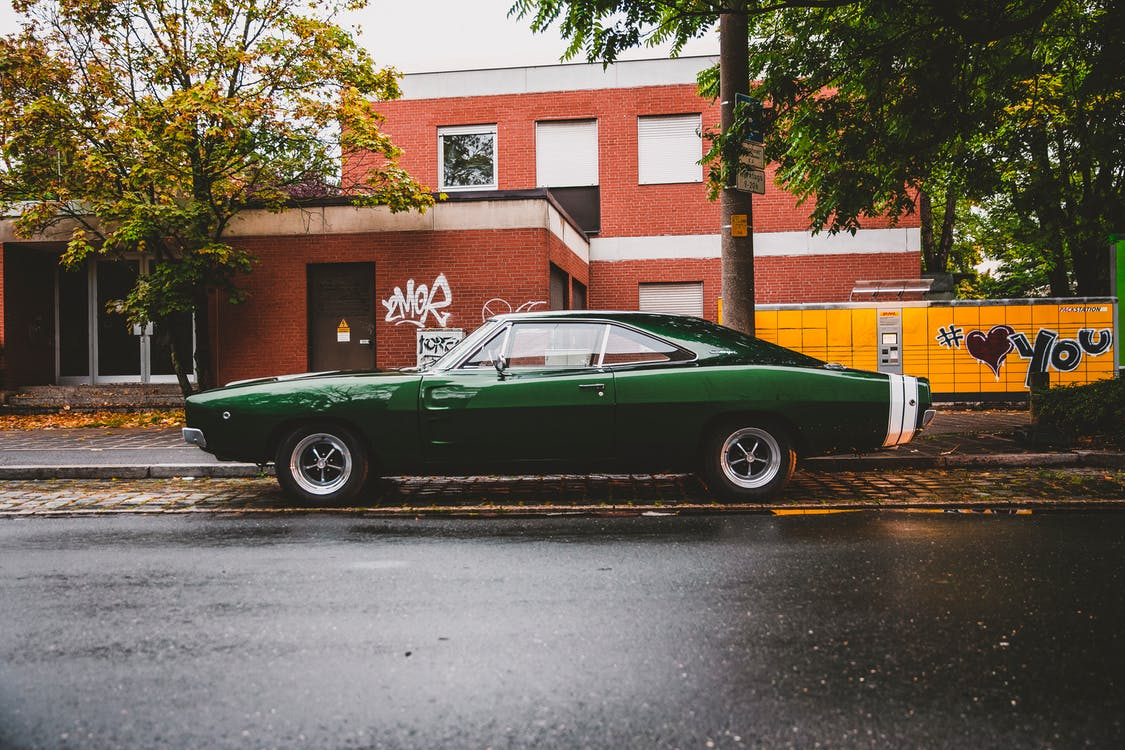 Photo Of Green Coupe Parked On Pavement