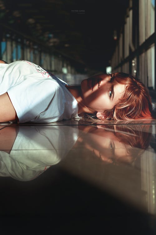 Woman Laying On Ground
