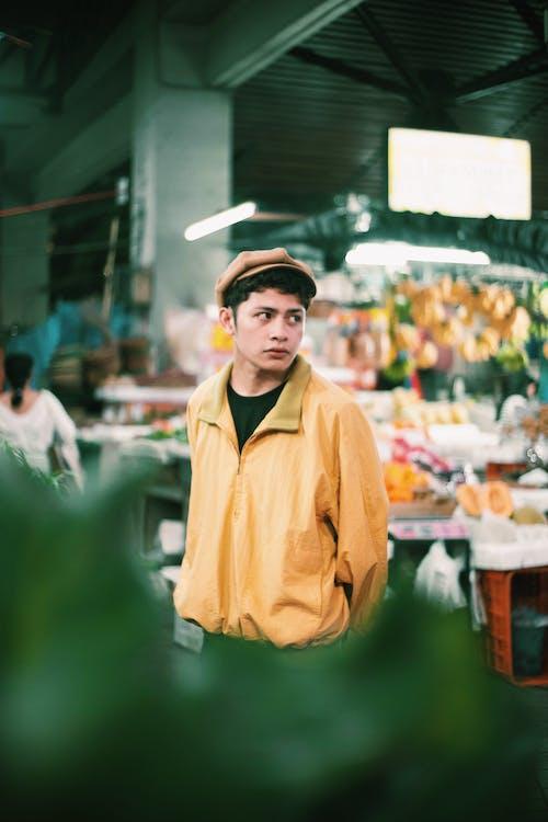 Man Wears Yellow Jacket