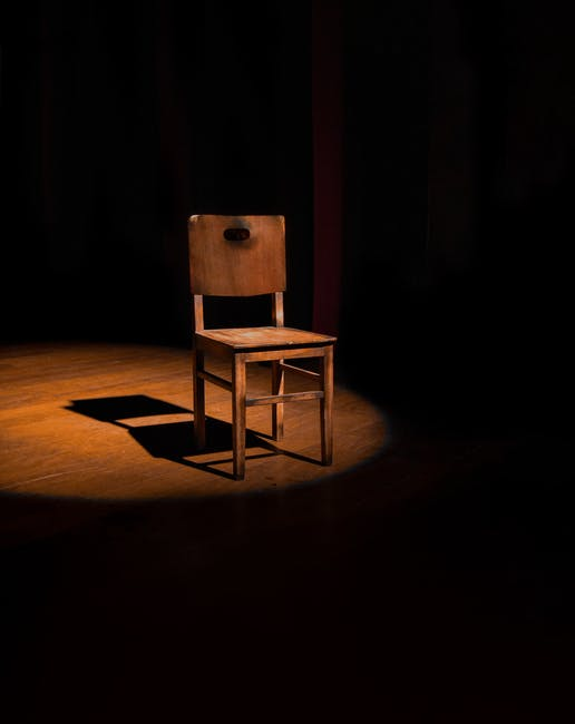 Empty brown wooden armless chair