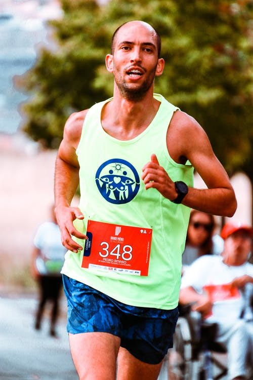 Shallow Focus Photo of Man In Active Sports Wear Running