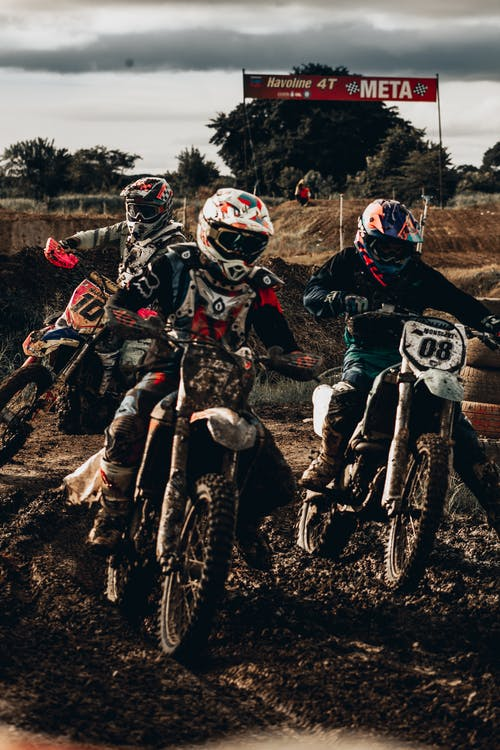 People Riding on Motocross Dirt Bikes In Competition