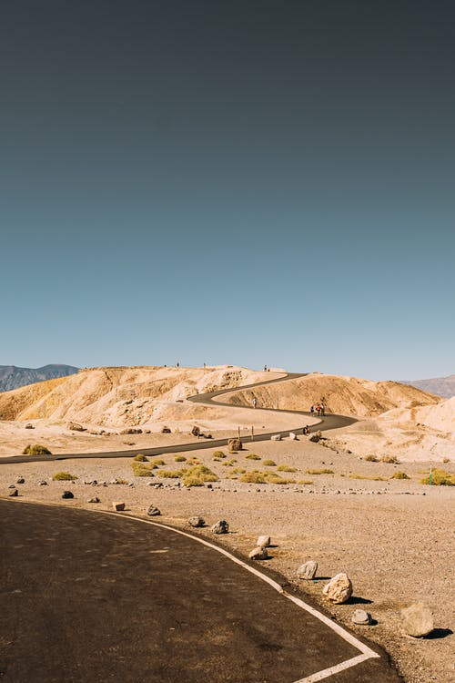 Wide Winding Road In The Desert Under Blue Sky