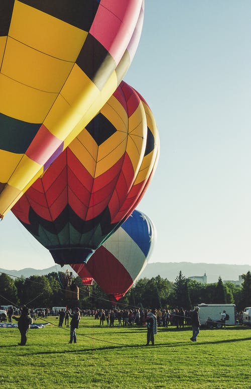 Three Assorted Coloured Hot Air Balloons