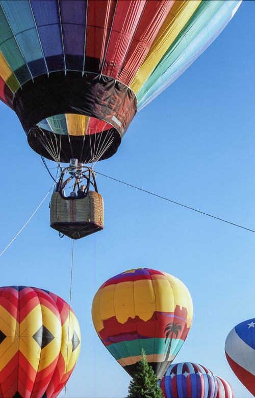 Low Angle Shot Of A Colorful Hot Air Balloons Floating