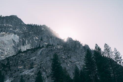 Grayscale Photo Of Rocky Mountain Peaks