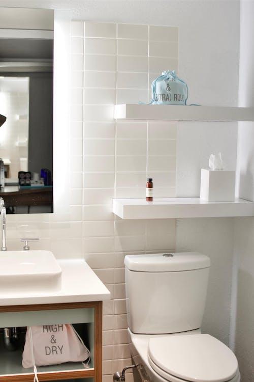 A Clean White Tiled Bathroom