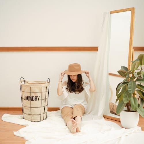 Woman Sitting Beside A Mirror
