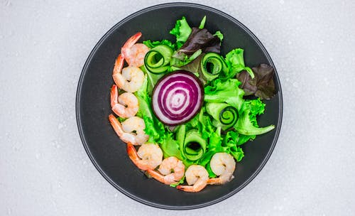 Close-up Of A Steamed Shrimp Salad With Fresh Vegetables In A Metal Bowl