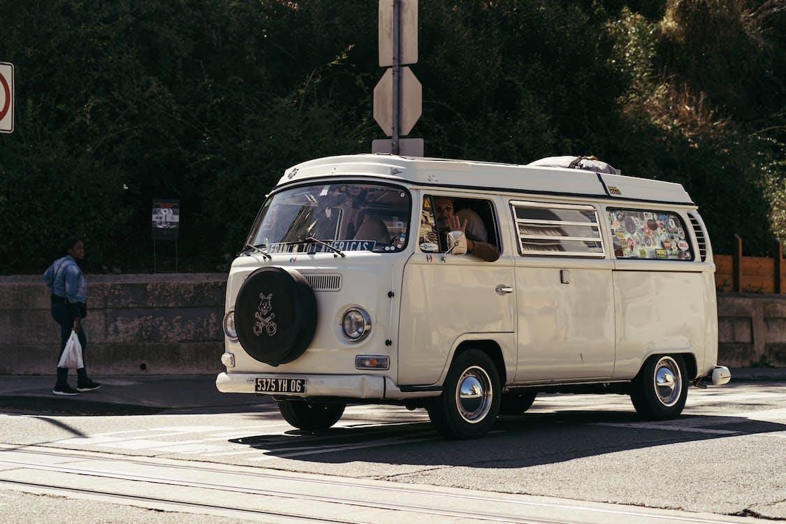 Shallow Focus Photo Of White Volkswagen Van